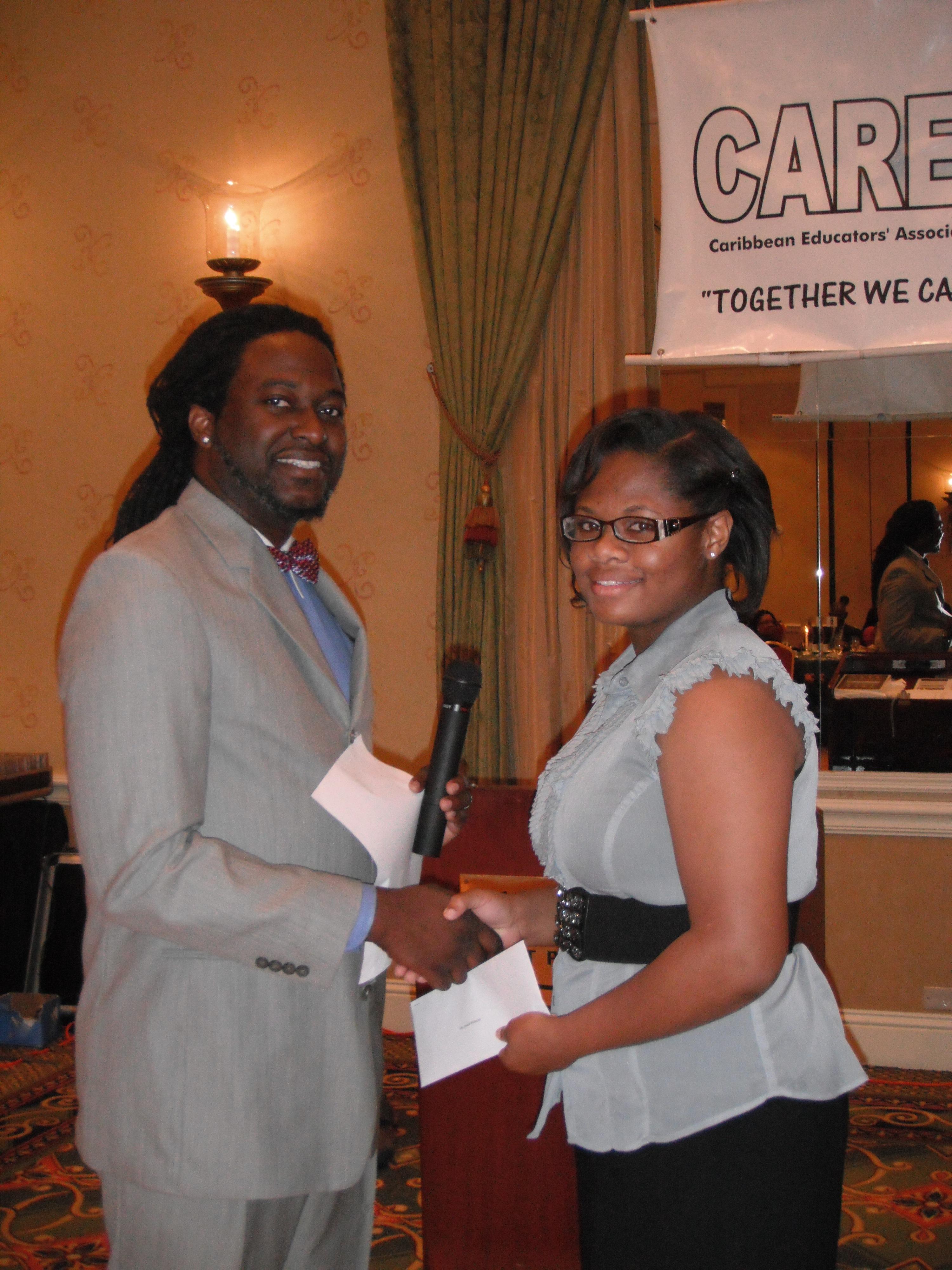 8 Scholarship Recipient with Presenter at Caribbean Educators Association Annual Scholarship Awards 2012