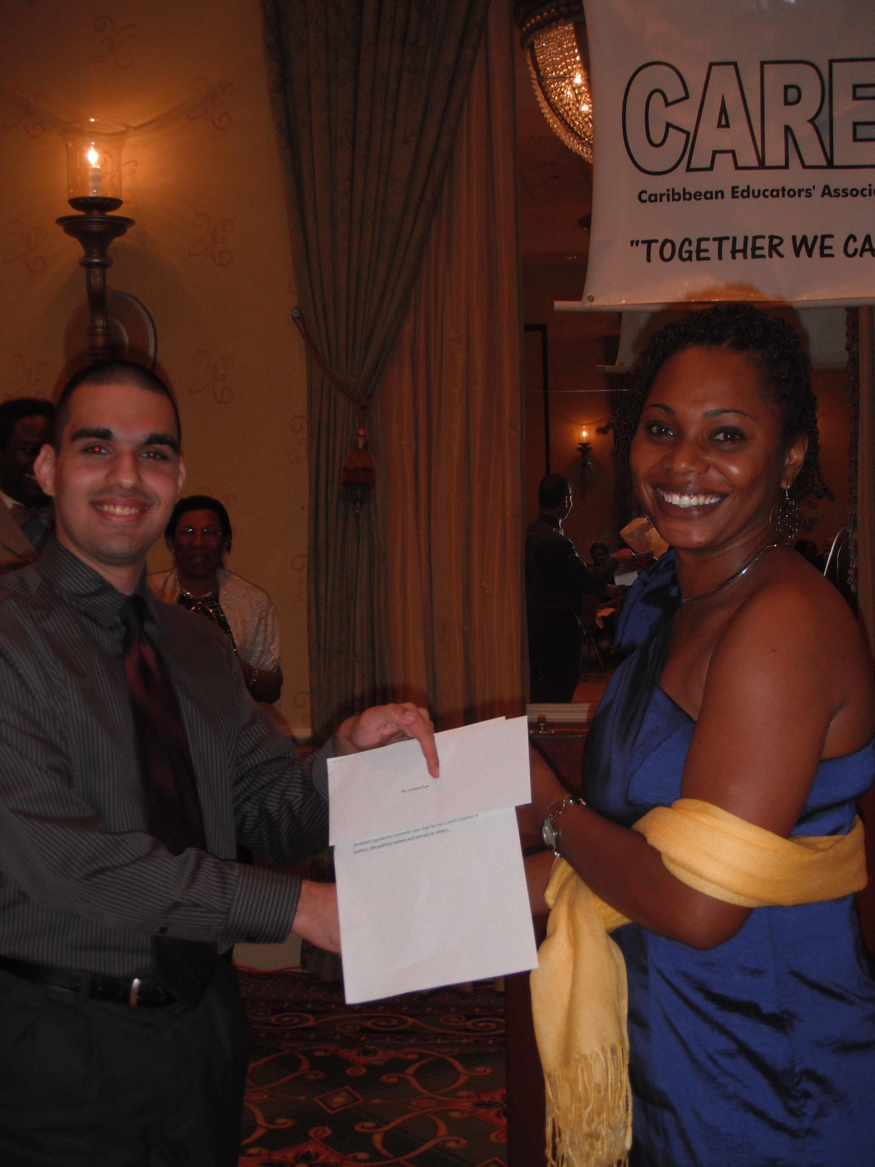9 Scholarship Recipient with Presenter at Caribbean Educators Association Annual Scholarship Awards 2012