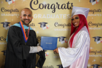 Picture 08 a – Dr. Terrence Narinesingh, Ph.D. at Broward County Public Schools Graduation with graduating senior Justina Brown